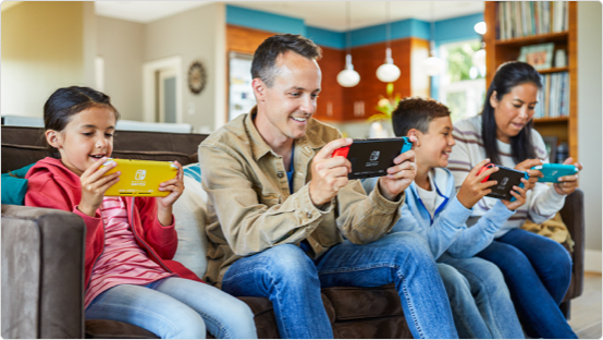 Family playing on their Nintendo Switch Consoles